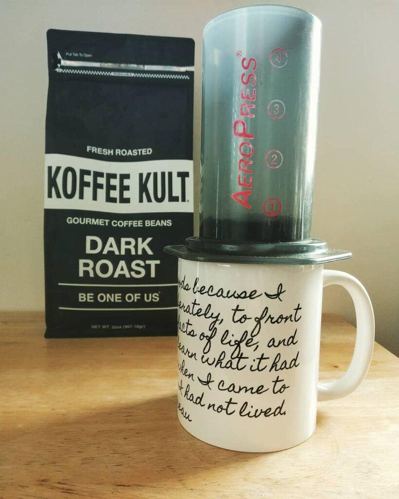 Koffee Kult dark roast coffee and coffee mug